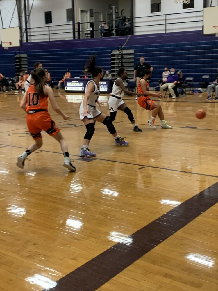 The Waterville and Winslow girls basketball teams compete during a game Tuesday night in Watervile.