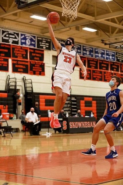 Skowhegan's Jimmy Reed goes up for a layup during a game against Lawrence on Friday night in Skowhegan.