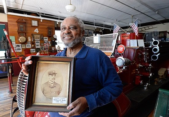 Bob Greene of South Portland holds a photo of his ancestor, William Wilberforce Ruby, who is credited with discovering the Great Fire of 1866 and later became a firefighter and city leader.