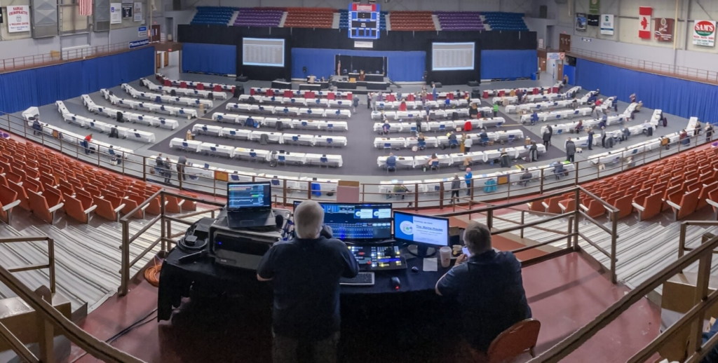 Bryan Finnemore, left, and Andrew Collar of Digital Spirit Media sit at the control panels for live stream, waiting for House session to start Wednesday at the Augusta Civic Center.