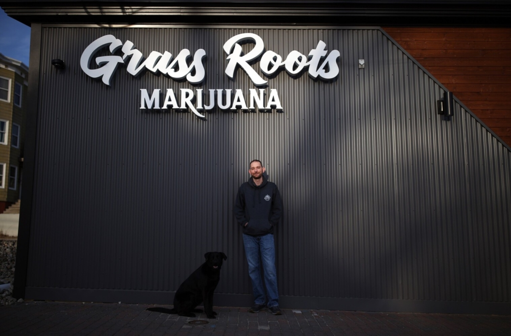 Jim Hamilton, owner Grass Roots, stands outside his soon-to-be-opened business at 377 St. John St. in Portland with his dog, Carley. With the approval of two licenses on Wednesday, Portland's recreational marijuana market is officially open for business, nearly five months after the statewide market launch.