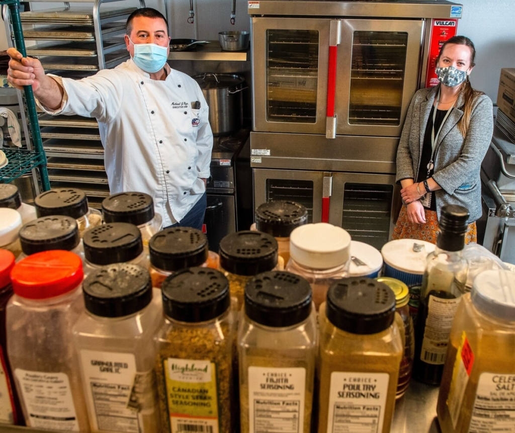 Michael Flynn, left, nutritional director for Regional School Unit 12, and Chelsea Elementary School Principal Allison Myers stand in the school's kitchen on March 30. RSU 12 is getting a grant to strengthen it's local food partnerships.