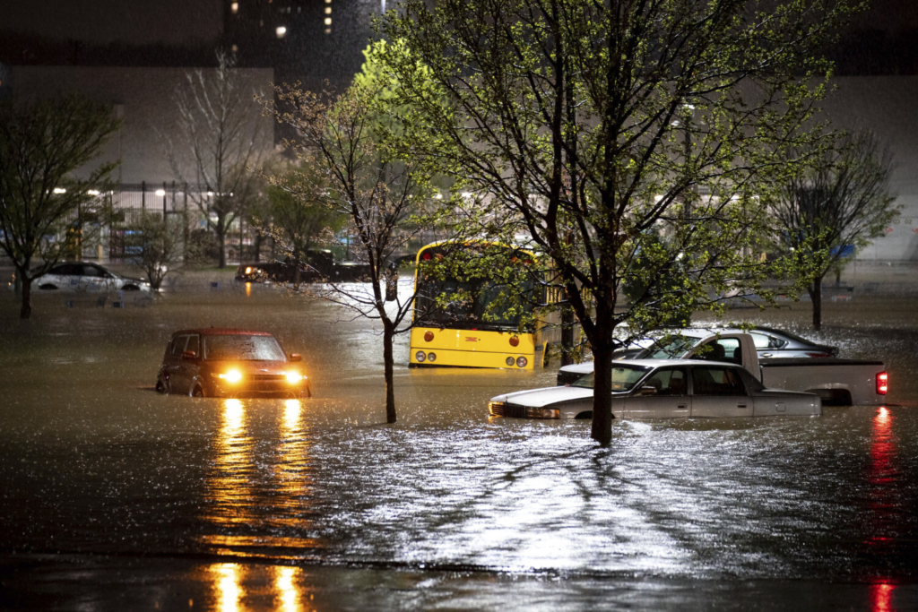 Cars stranded in a Walmart parking lot on Nolensville Pike in Nashville, Tenn., Sunday, March 28, 2021. Heavy rain across Tennessee flooded homes and roads early Sunday, prompting officials to rescue numerous people from houses, apartments and vehicles as a line of severe storms crossed the state. (Andrew Nelles/The Tennessean via AP)