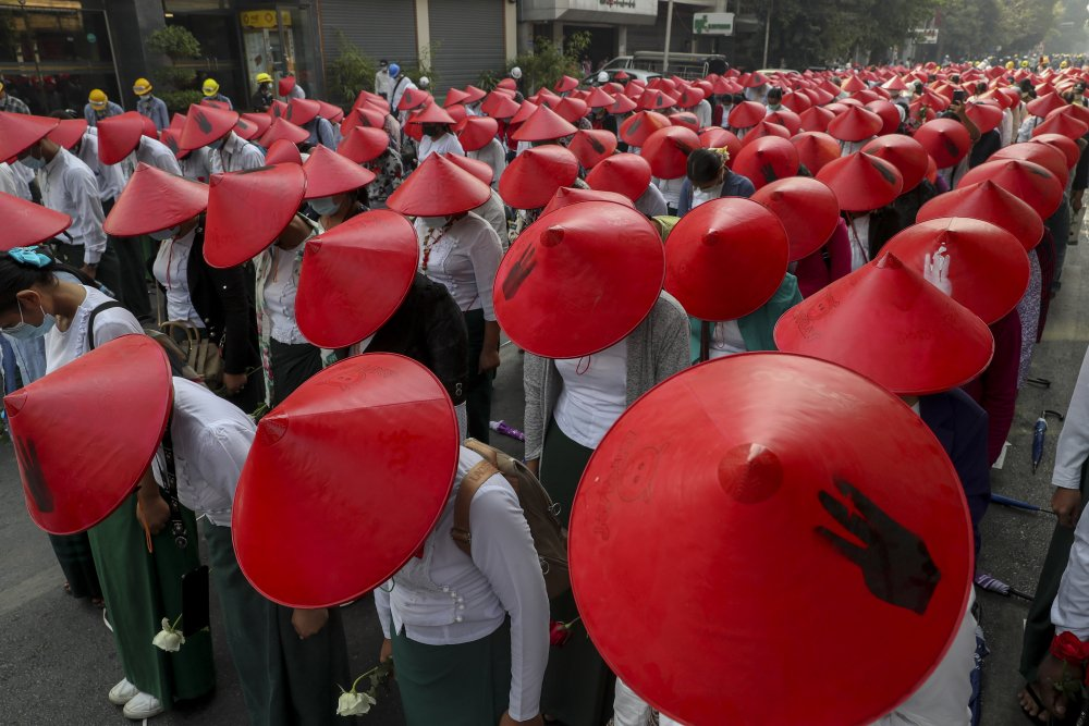 Anti-coup school teachers in their uniform and traditional Myanmar-hats participate in a demonstration in Mandalay, Myanmar, Wednesday, March 3. Demonstrators in Myanmar took to the streets again on Wednesday to protest last month's seizure of power by the military.