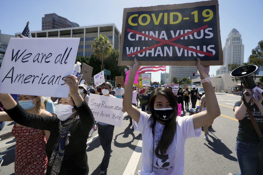 Protestors march at a rally against Asian hate crimes past the Los Angeles Federal Building in downtown Los Angeles , Saturday, March 27. The gathered crowd demanded justice for the victims of the Atlanta spa shooting and for an end to racism, xenophobia and misogyny.