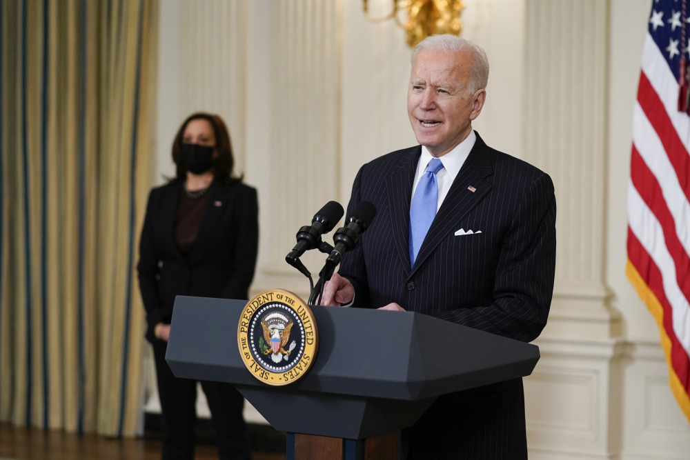 President Joe Biden, accompanied by Vice President Kamala Harris, speaks about efforts to combat COVID-19, in the State Dining Room of the White House, Tuesday, March 2, in Washington.
