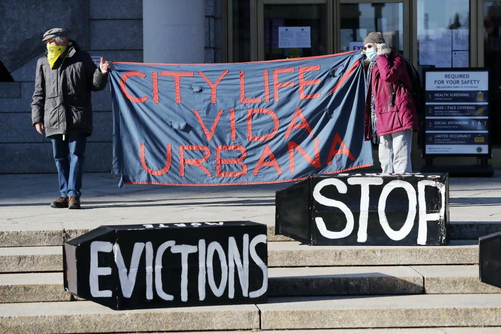 Tenants' rights advocates demonstrate in front of the Edward W. Brooke Courthouse in Boston in January. The Biden administration is extending through June a federal moratorium on evictions of tenants who've fallen behind on rent during the coronavirus pandemic.