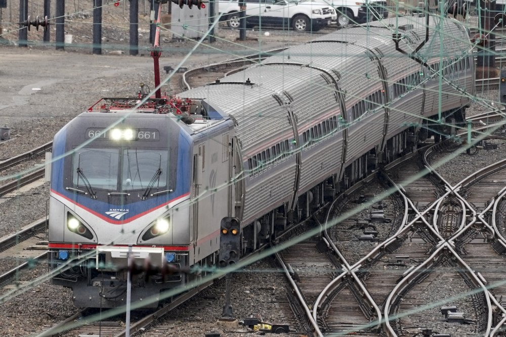 An Amtrak train departs 30th Street Station in Philadelphia on Wednesday. President  Biden and lawmakers are laying the groundwork for another of his top legislative priorities – a long-sought boost to the nation's roads, bridges and other infrastructure that could meet Republican resistance to a hefty price tag.