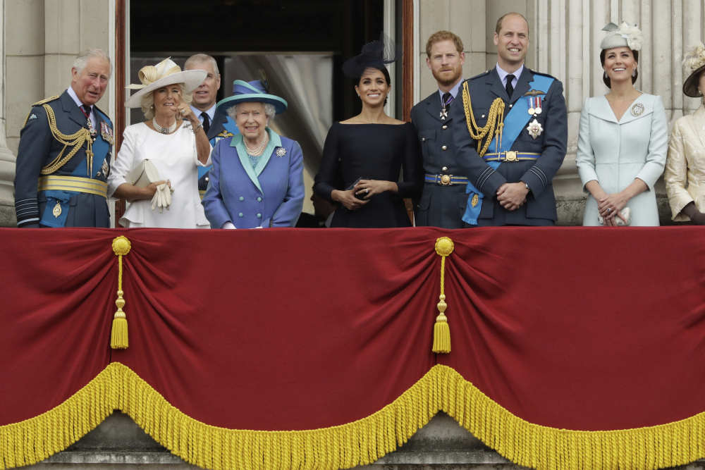 Members of the royal family gather on the balcony of Buckingham Palace in 2018. From left, Britain's Prince Charles, Camilla the Duchess of Cornwall, Prince Andrew, Queen Elizabeth II, Meghan the Duchess of Sussex, Prince Harry, Prince William and Kate the Duchess of Cambridge. The Duke and Duchess of Sussex will finally get the chance to tell the story behind their departure from royal duties directly to the public on Sunday, when their two-hour interview with Oprah Winfrey is broadcast.