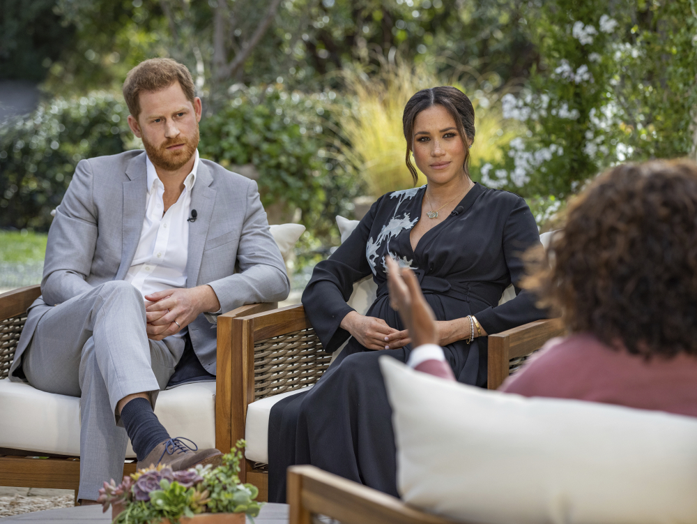 Prince Harry, left, and Meghan, Duchess of Sussex, in conversation with Oprah Winfrey.