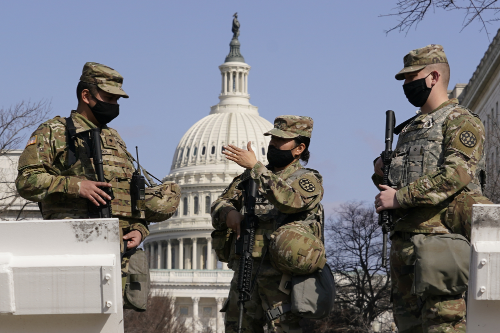 Members of the National Guard stand guard at the Capitol in Washington on Thursday.