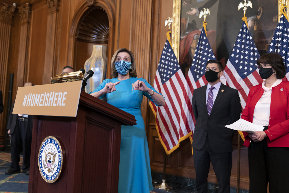 Speaker of the House Nancy Pelosi, D-Calif., joined at right by Rep. Raul Ruiz, D-Calif., chairman of the House Hispanic Caucus, and Rep. Lucille Roybal-Allard, D-Calif., discusses the upcoming vote on the American Dream and Promise Act of 2021, a bill to help reform the immigration system, at the Capitol in Washington on Thursday.