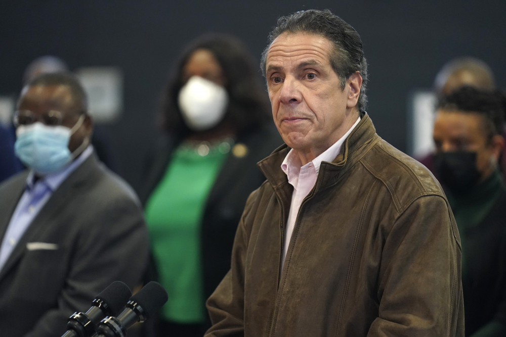 New York Gov. Andrew Cuomo, right, pauses to listen to a reporter's question during a news conference at a COVID-19 vaccination site in the Brooklyn borough of New York on Feb. 22.