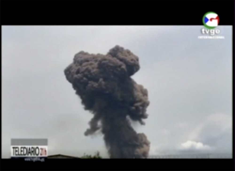 Smoke rises over the blast site at a military barracks in Bata, Equatorial Guinea, Sunday. A series of explosions killed at least 20 people and wounded more than 600 others on Sunday, authorities said.