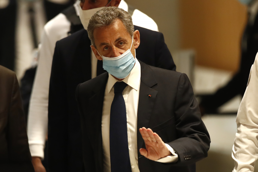 Former French President Nicolas Sarkozy arrives at the courtroom Monday in Paris.