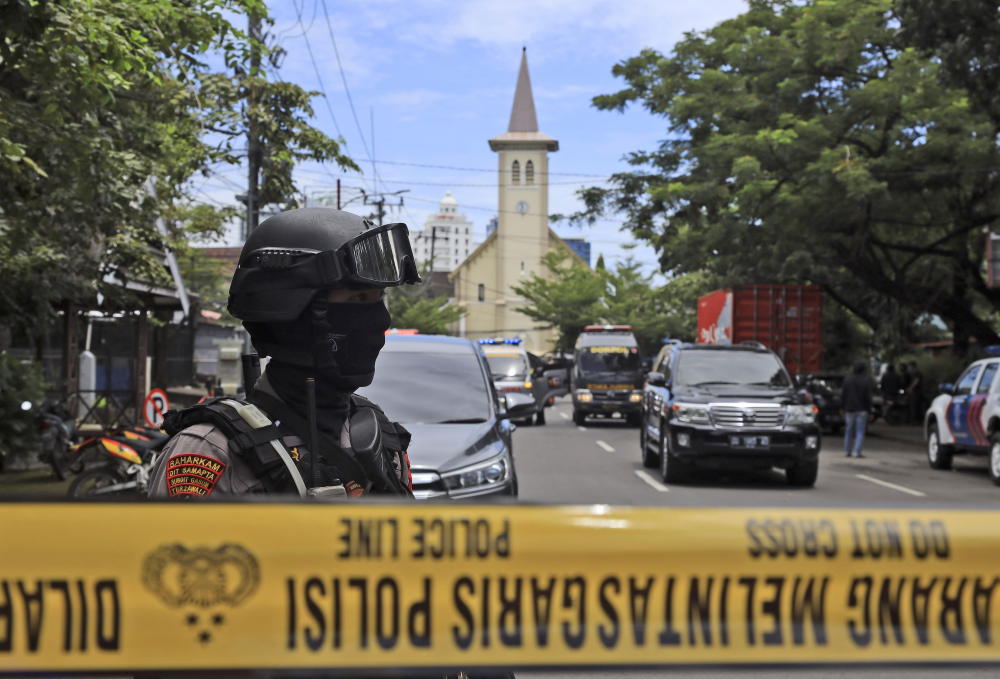 A police officer stands guard near Sacred Heart of Jesus Cathedral in Makassar, South Sulawesi, Indonesia, on Sunday.