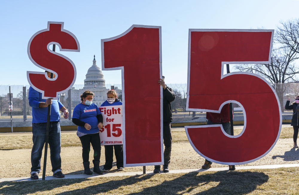 Activists appeal for a $15 minimum wage near the Capitol in Washington on Feb. 25.