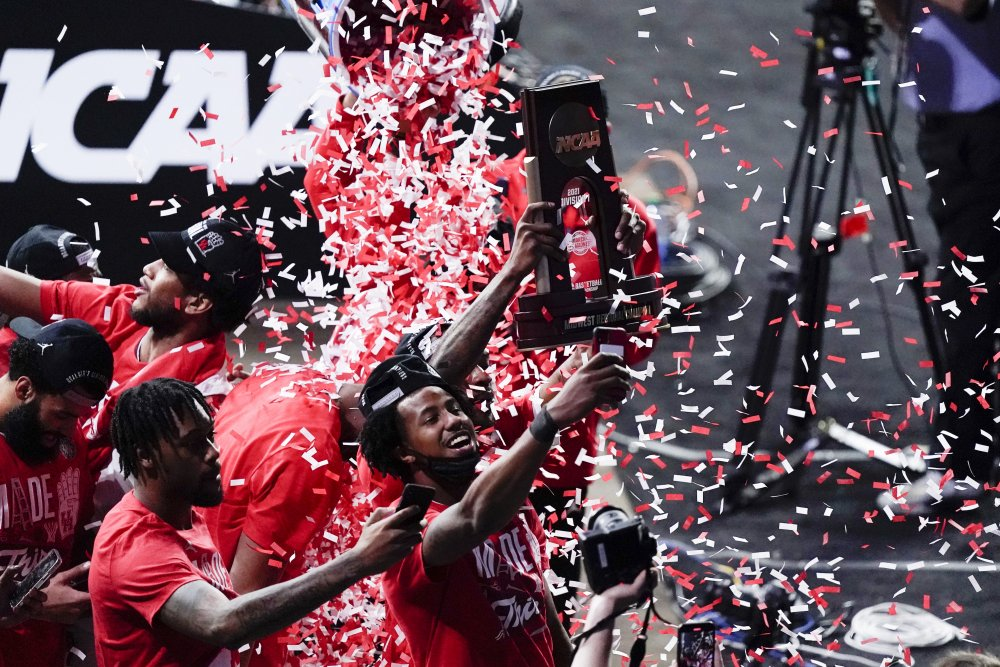 Houston players celebrate their 67-61 win over Oregon State during an Elite 8 game in the NCAA men's college basketball tournament at Lucas Oil Stadium, Monday, March 29, in Indianapolis.