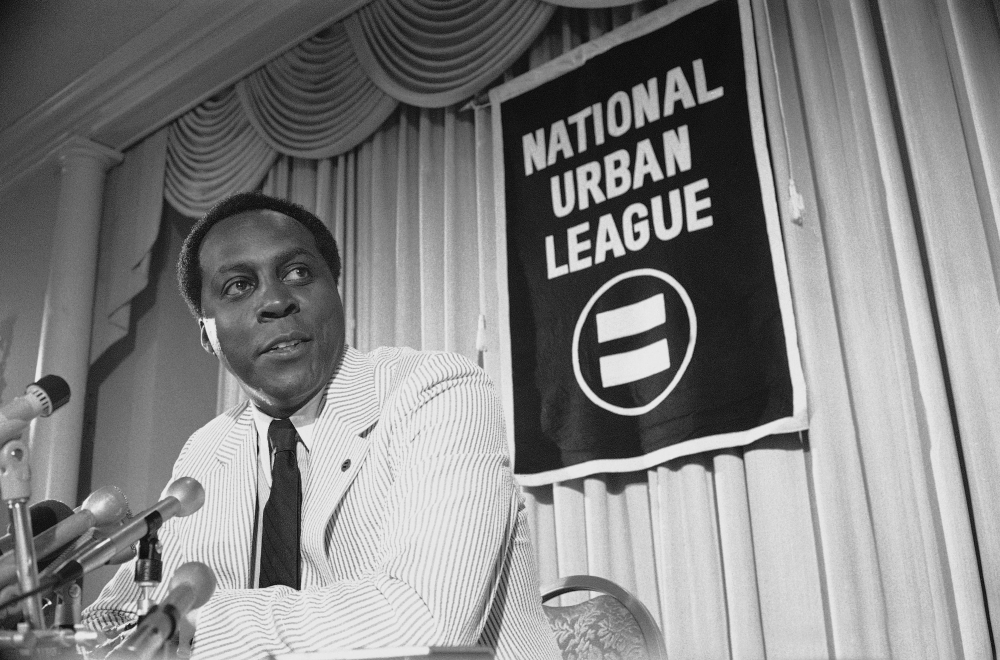 Vernon Jordan, President of the National Urban League, talks to reporters during a press conference in Washington in 1977.  Jordan, who rose from humble beginnings in the segregated South to become a champion of civil rights before reinventing himself as a Washington insider and corporate influencer, died Tuesday. He was 85.