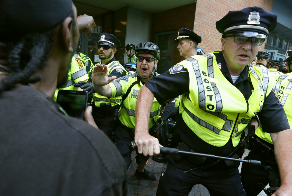 """Counterprotesters clash with police following a """"Free Speech"""" rally staged by conservative activists Aug. 19, 2017, in Boston. Boston's police department remains largely white in 2021, despite vows for years by city leaders to work toward making the police force look more like the community it serves."""