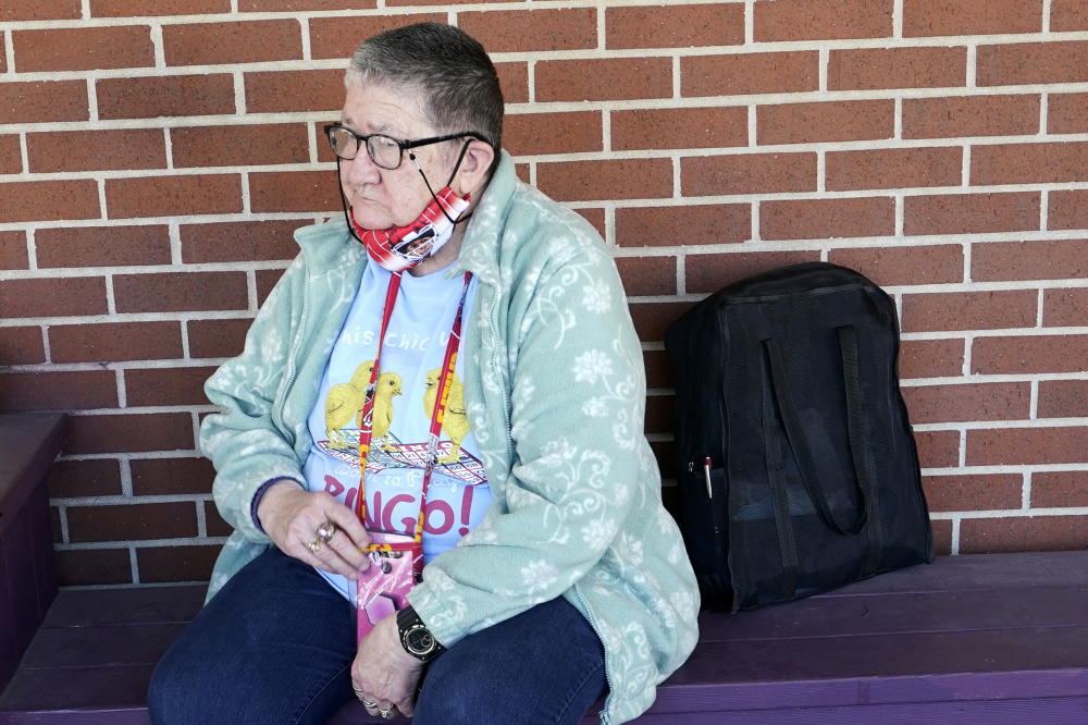 Pat Brown waits outside the Don Bosco Senior Center in Kansas City, Mo., on Wednesday. Brown knows she needs the vaccine because her asthma and diabetes put her at higher risk of serious COVID-19 complications. But Wall hasn't attempted to schedule an appointment and didn't even know if they were being offered in her area yet; she says she is too overwhelmed.
