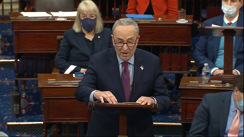 In this image from video, Senate Majority Leader Chuck Schumer of New York speaks before the final vote on the Senate version of the COVID-19 relief bill in the Senate at the U.S. Capitol in Washington on Saturday. The House is expected to vote on the bill on Wednesday.