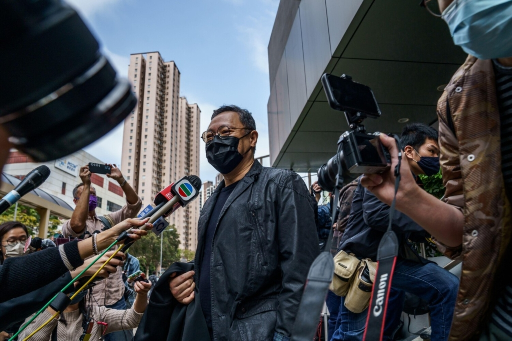 Pro-democracy activist Benny Tai arrives at Ma On Shan police station in Hong Kong on Sunday.