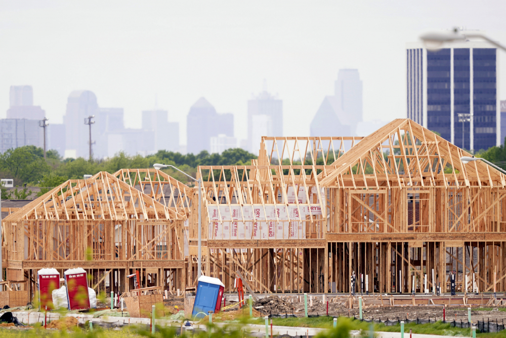 The frame of new home under construction rises n a neighborhood under development in north Dallas last week. The first numbers from the 2020 census show southern and western states gaining congressional seats.