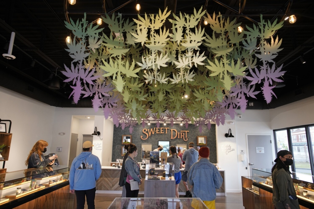 "Customers place orders Tuesday at Sweet Dirt, an adult use cannabis dispensary in Portland, on the first April 20, also known as ""4/20"" or ""stoner Christmas,"" for legal adult-use cannabis in Maine."