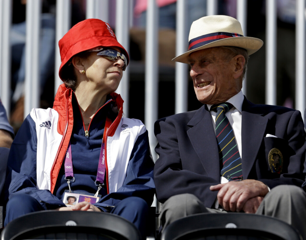 """Princess Anne, left, attends the equestrian eventing dressage phase with her father Prince Phillip, the Duke of Edinburgh, at the 2012 Summer Olympics on July 29 in London. In a message released by Buckingham Palace on Sunday, Anne praised Philip's """"ability to treat every person as an individual in their own right with their own skills,"""" a nod to the many charities and other organizations he was involved with."""