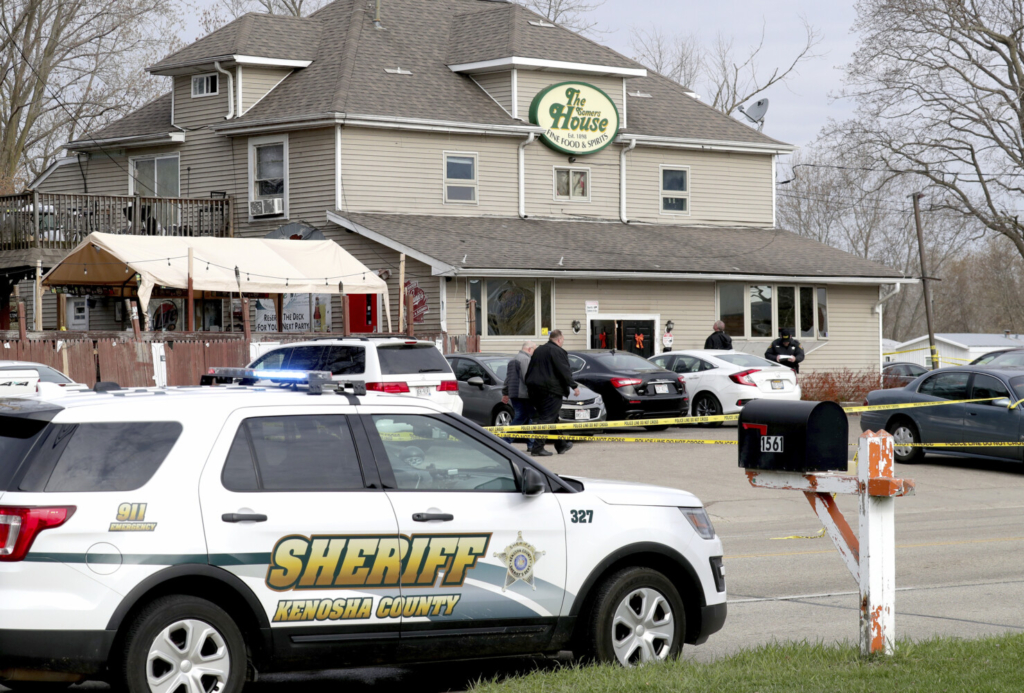 "Officials investigate the scene of a deadly shooting at Somers House Tavern in Kenosha, Wis., on Sunday. ""We believe our suspect knew who he was targeting,"" said Kenosha County Sheriff David Beth."