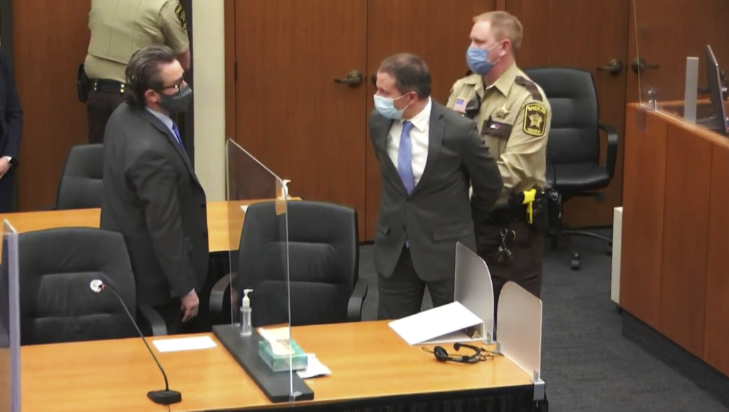 In this image from video, former Minneapolis police officer Derek Chauvin, center, is taken into custody as his attorney, Eric Nelson stands at left, after the verdicts were read at Chauvin's trial for the 2020 death of George Floyd, on April 20 at the Hennepin County Courthouse in Minneapolis, Minn.