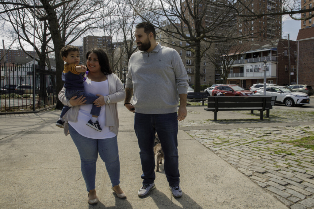 """Priscila Medina with her husband, Jason Sanchez, and her son in the Rego Park neighborhood of Queens in New York City. When Medina got sick last month and needed hospital care, she received a novel drug that supplies virus-blocking antibodies, and """"by the next day I was able to get up and move around,"""" she said."""