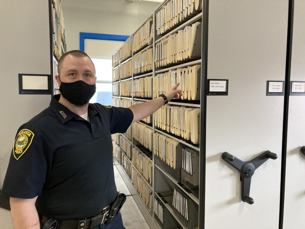 Christopher Hutchings, court officer for the Augusta Police Department,  shows the large filing system the department uses to store information and important files.