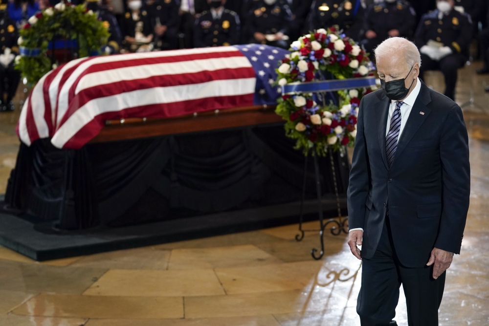 "President Joe Biden walks from the podium after speaking during a ceremony to honor slain U.S. Capitol Police officer William ""Billy"" Evans as he lies in honor at the Capitol in Washington, Tuesday, April 13."