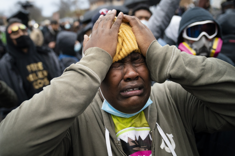 A demonstrator reacts during a standoff with police along a perimeter fence during a protest decrying the shooting death of Daunte Wright, outside the Brooklyn Center Police Department on Wednesday in Brooklyn Center, Minn.