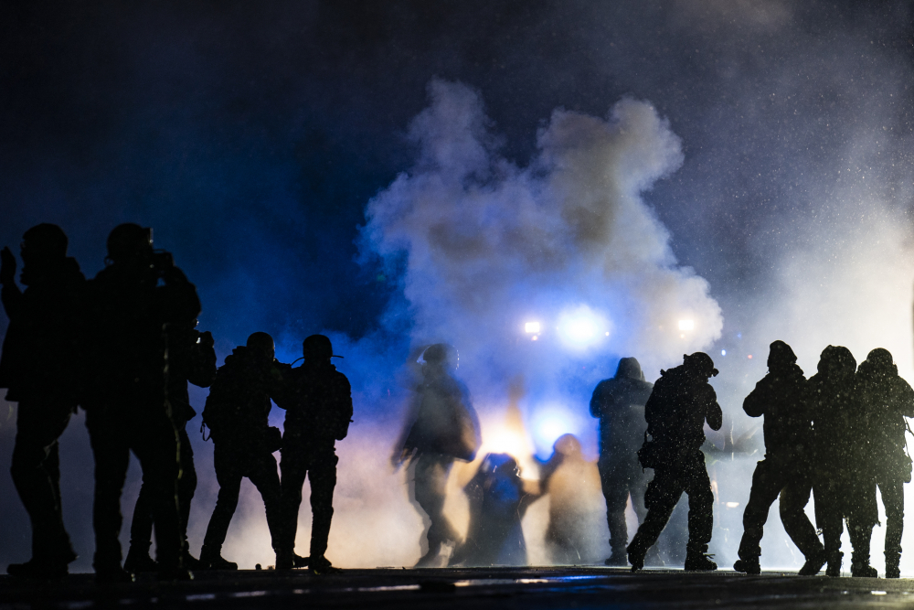 Authorities fire gas munitions at demonstrators gathered outside the Brooklyn Center Police Department to protest the shooting death of Daunte Wright, late Tuesday in Brooklyn Center, Minn.