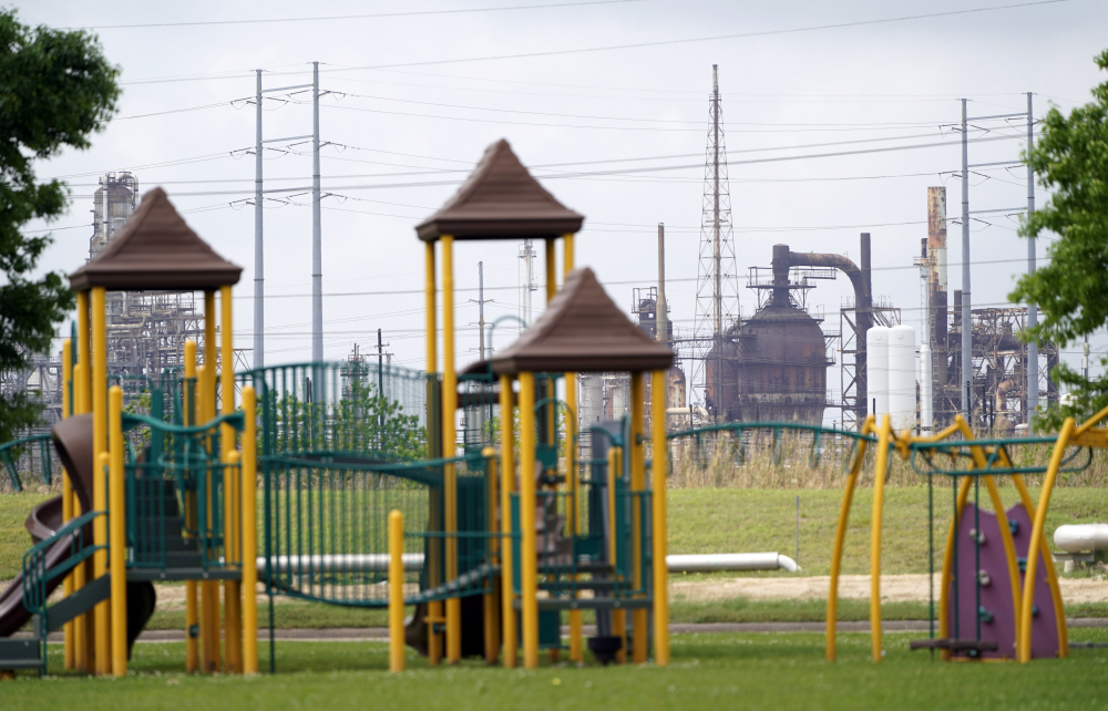 A playground outside the Prince Hall Village Apartments sits empty near one of the petrochemical facilities March 23 in Port Arthur, Texas.