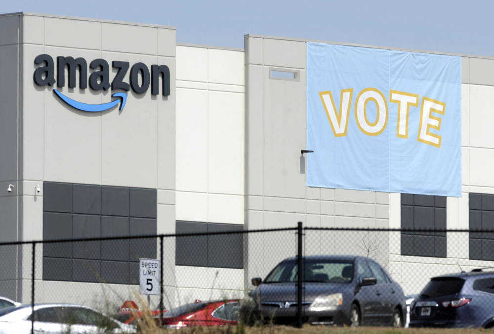 Abanner encouraging workers to vote in labor balloting is shown March 30 at an Amazon warehouse in Bessemer, Ala.
