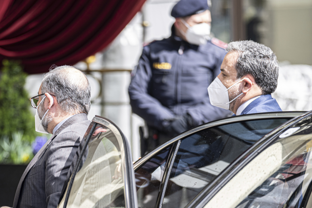 """Political deputy at the Ministry of Foreign Affairs of Iran, Abbas Araghchi, right, arrives at the Grand Hotel Wien in Vienna on Tuesday for a closed-door meeting on the Joint Comprehensive Plan of Action. Araghchi said """"lifting U.S. sanctions is the first and the most necessary action for reviving the deal."""""""