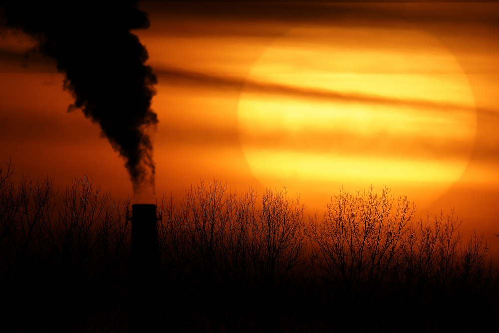 Emissions from a coal-fired power plant are silhouetted against the setting sun Feb. 1 in Independence, Mo.