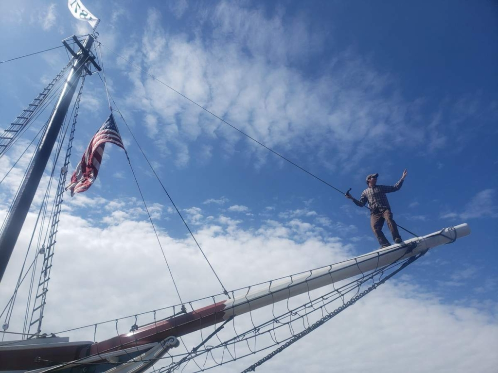 Capt. Garth Wells balances on the bowsprit of the schooner Lewis R. French just before the 150-year-old vessel was launched Wednesday back into the waters at North End Shipyard.
