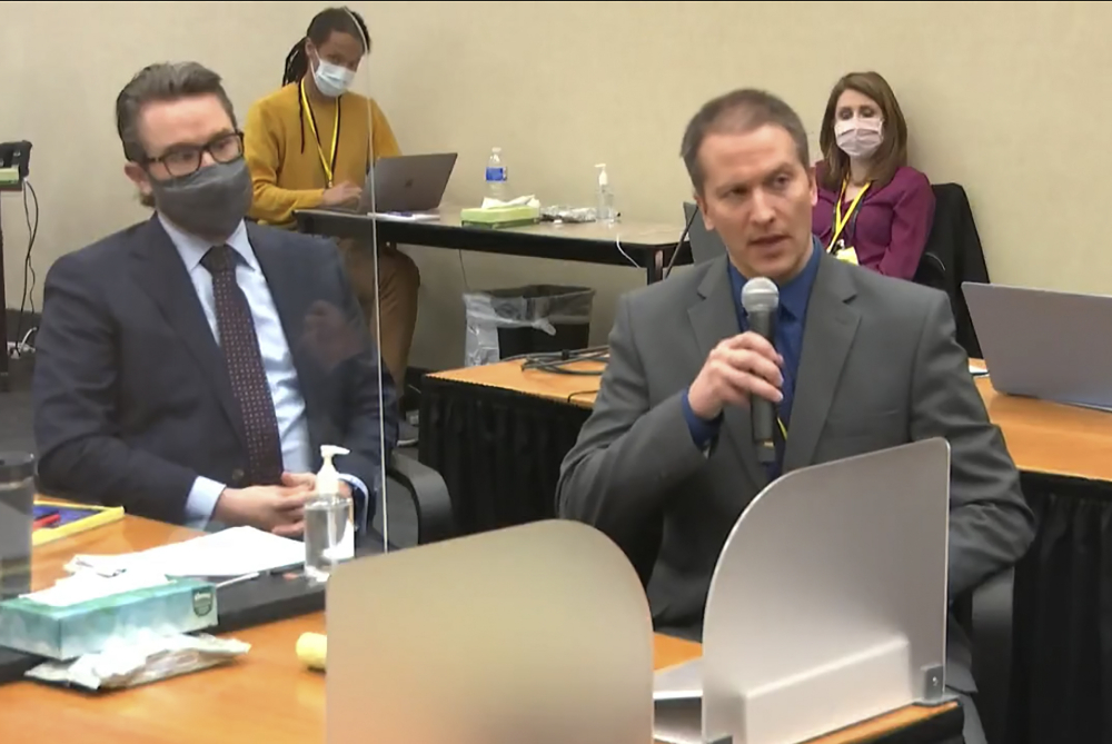 In this image from video, defense attorney Eric Nelson, left, and defendant, former Minneapolis police officer Derek Chauvin address Hennepin County Judge Peter Cahill during motions on April 15.
