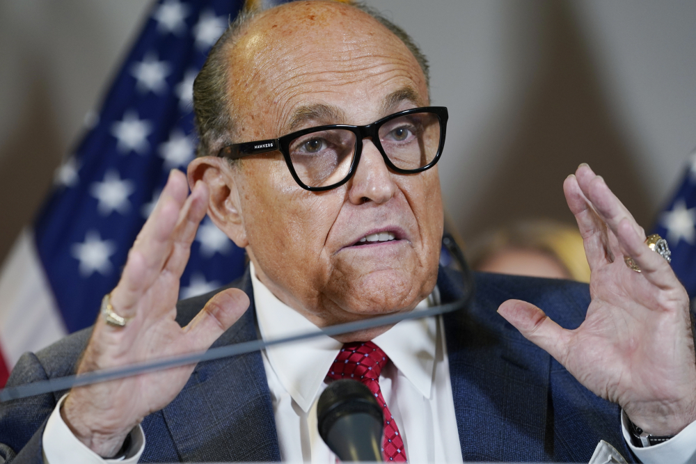 Former New York Mayor Rudy Giuliani speaks during a news conference at the Republican National Committee headquarters in Washington in November 2020. Federal agents raided Giuliani's Manhattan home and office on Wednesday, April 28, seizing computers and cellphones in a major escalation of the Justice Department's investigation into the business dealings of former President Donald Trump's personal lawyer.