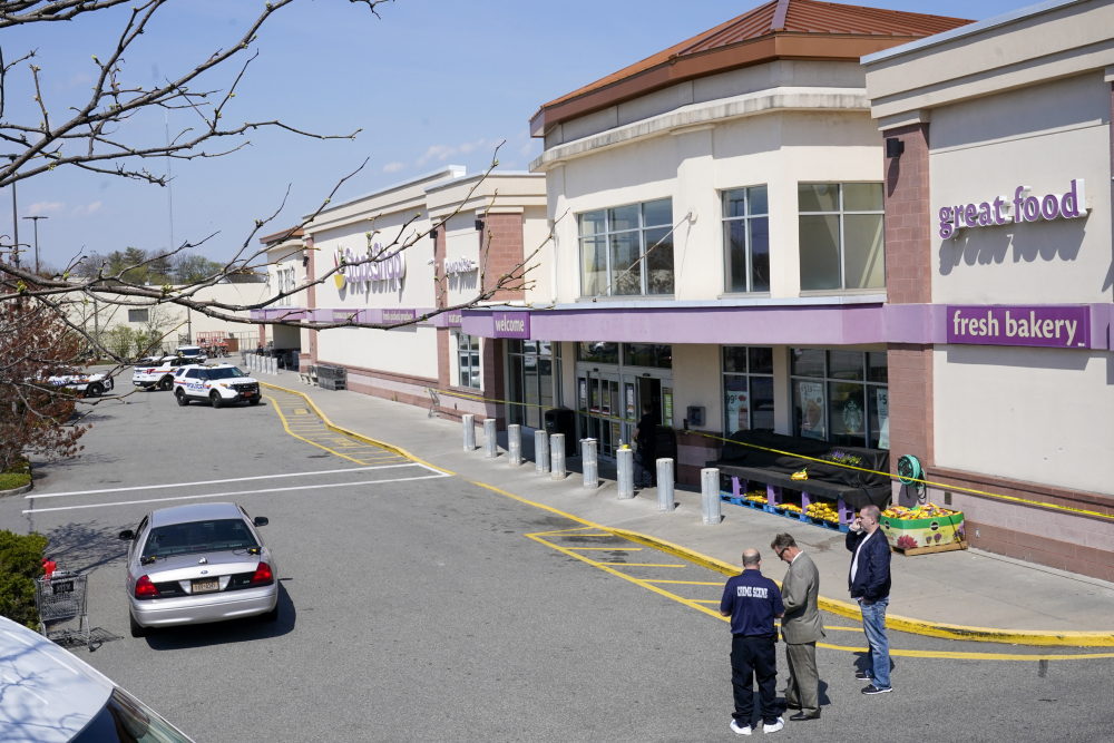 Emergency service personnel work at the scene of a shooting at a Stop & Shop supermarket on Tuesday in West Hempstead, N.Y. A gunman shot three workers inside a manager's office at the store, killing one of them, police said.