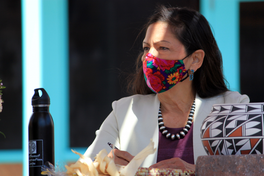 U.S. Interior Secretary Deb Haaland listens to tribal leaders and jots down notes during a round-table discussion at the Indian Pueblo Cultural Center in Albuquerque, N.M. on April 6, 2021.