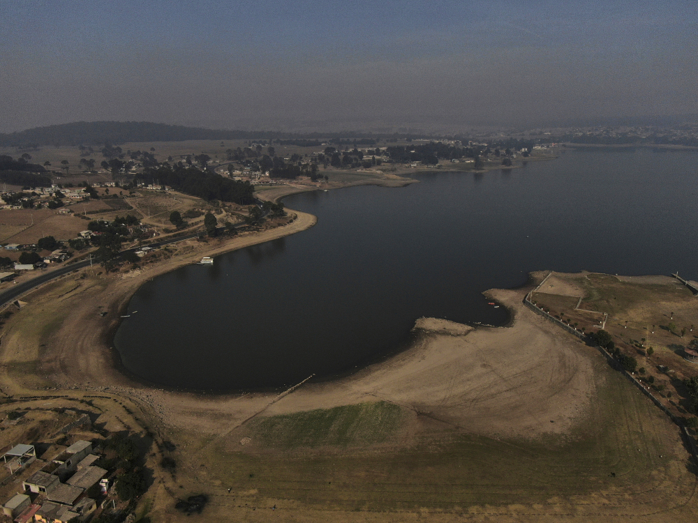 An aerial view of Villa Victoria Dam, the main water supply for Mexico City residents, on the outskirts of Toluca, Mexico, on Thursday. Drought conditions now cover 85 percent of Mexico.