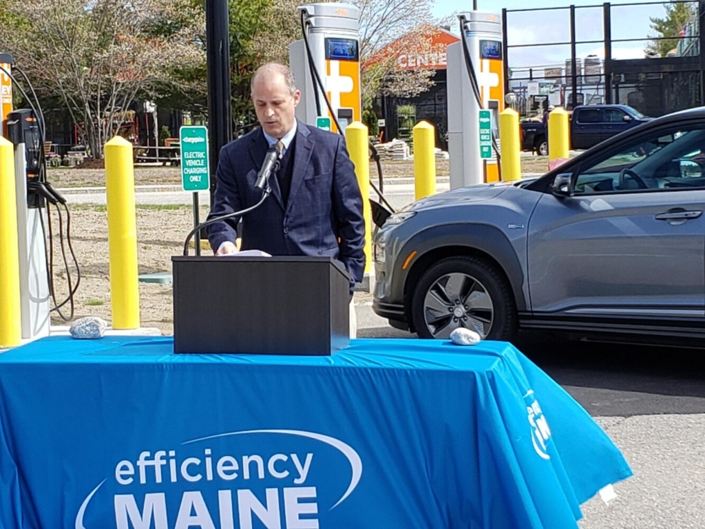 Michael Stoddard, executive director of Efficiency Maine, speaks during a ceremony Monday at a new electric vehicle charging station at the Hannaford supermarket in North Windham. The station is part of a new network of public charging stations meant to help encourage a transition to electric vehicles.