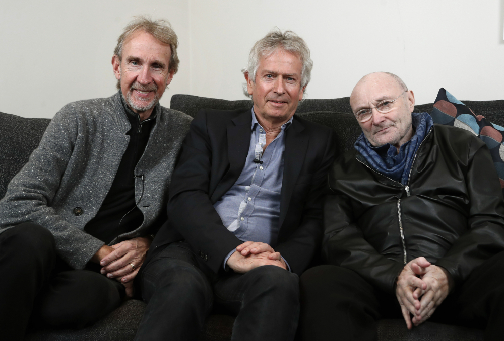 Genesis band members from left, Mike Rutherford, Tony Banks, and Phil Collins pose for a photo during an interview March 4, 2020, in London.