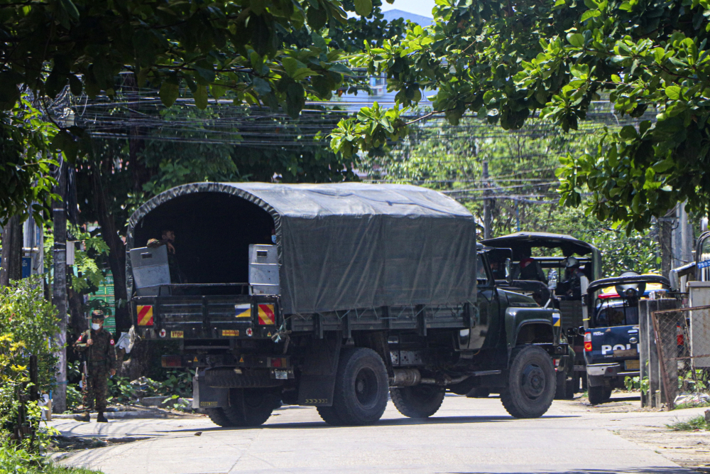 A police vehicle is parked on a road in South Okkalapa township to block anti-coup protesters from  gathering in Yangon, Myanmar, on Friday.